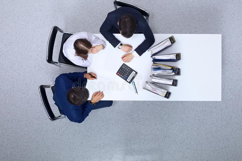 Business people at meeting, view from above. Bookkeeper or financial inspector making report, calculating or checki. Ng balance. Internal Revenue Service stock photos