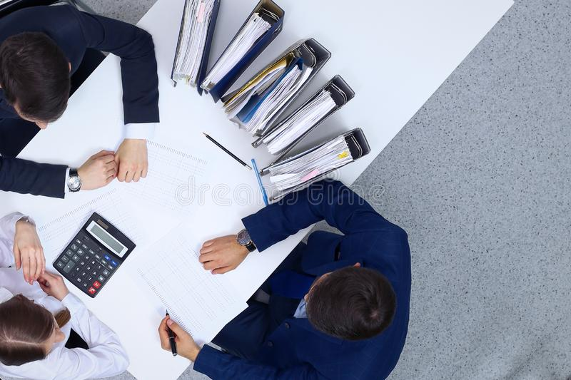 Business people at meeting, view from above. Bookkeeper or financial inspector making report, calculating or checki. Ng balance. Internal Revenue Service royalty free stock photography