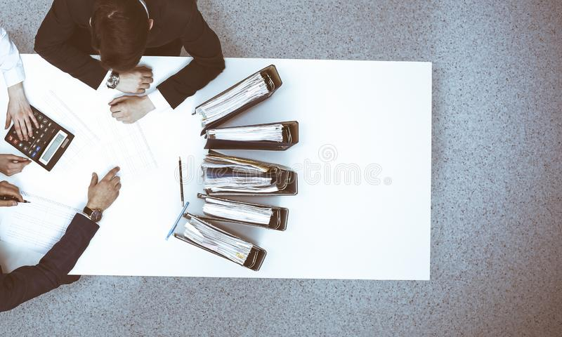 Business people at meeting, view from above. Bookkeeper or financial inspector making report, calculating or checking. Business people at meeting, view from royalty free stock image