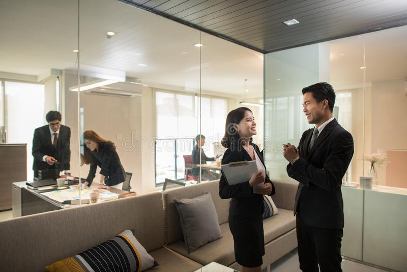 Business people in modern office,Colleagues sharing ideas royalty free stock photo