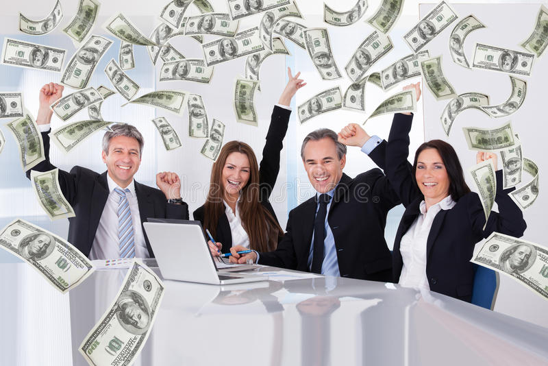 Business people with money rain in conference room stock photography
