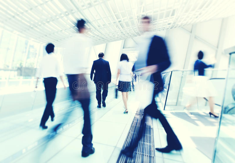 Business People in motion concept. Business people in Asia. Hong Kong. Tilt shift lense with selective focus, Blurred motion. Blue tint. concept royalty free stock photo