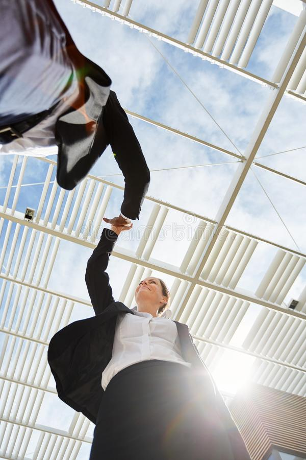 Business people are motivated by high five stock image