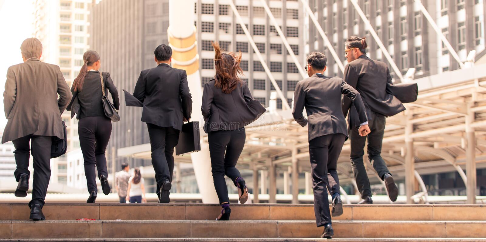 Business people moving running in city rush hours motion. Business people running in city stock photo