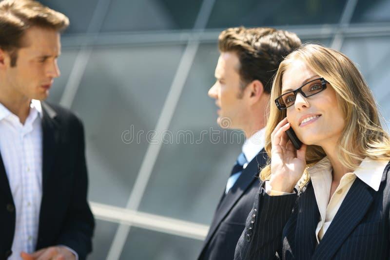 Business people near modern building stock photos