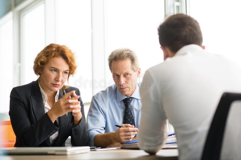 Business people negotiating royalty free stock photos
