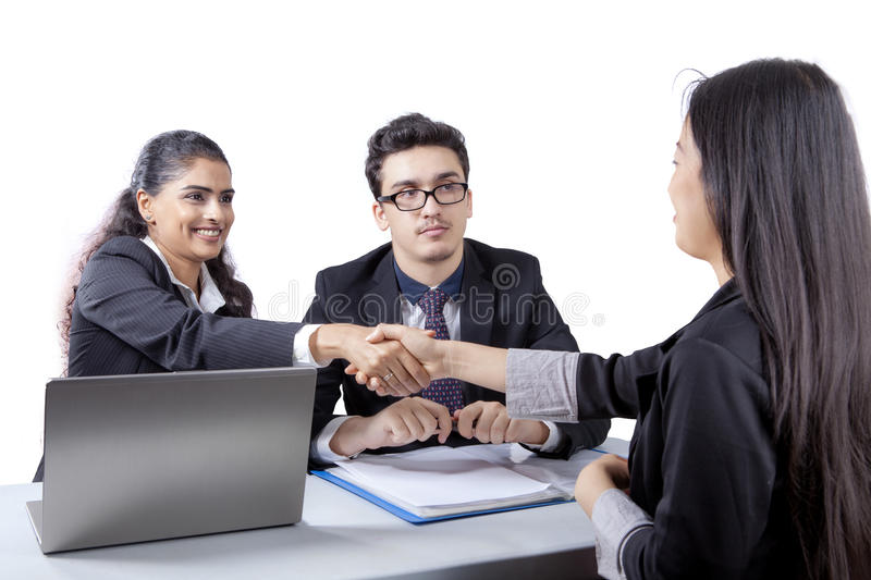 Business people with new employee stock photo