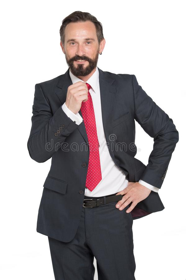 business, people and office concept - happy smiling businessman in suit. Bearded businessman in blue suit and red tie on white stock photo