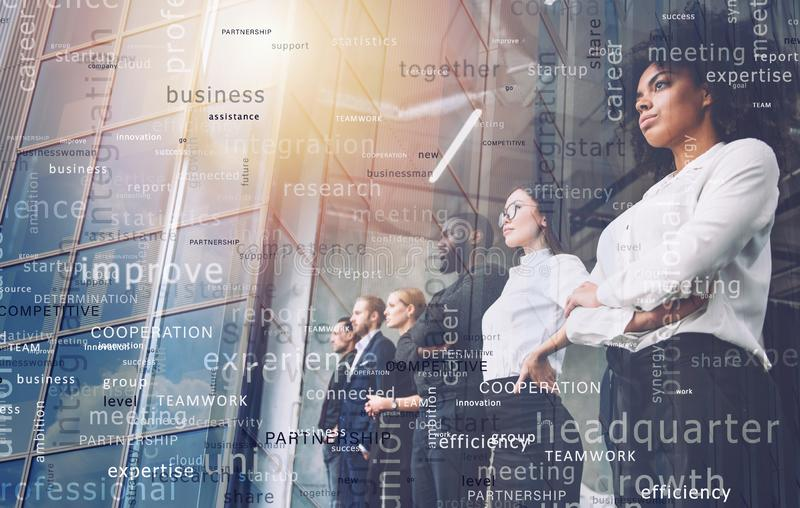 Business people in front of window look far. Future vision, teamwork startup an partnership concept. Double exposure. Business people in office in front of stock photos