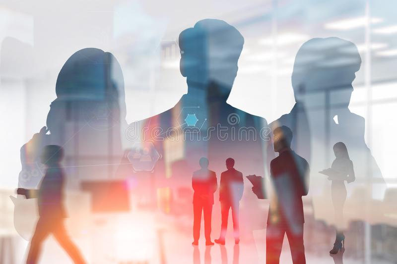 Business people in office, business interface. Silhouettes of managers with double exposure of business people working in office over cityscape background with royalty free stock images