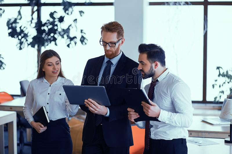 Group of happy business people discussing at office during business meeting royalty free stock photo