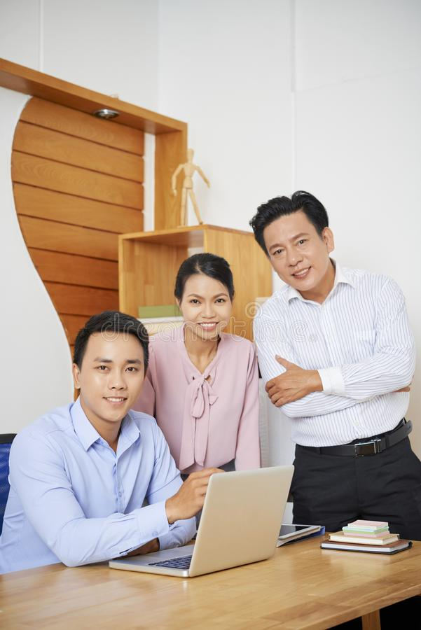 Business people at office table royalty free stock image