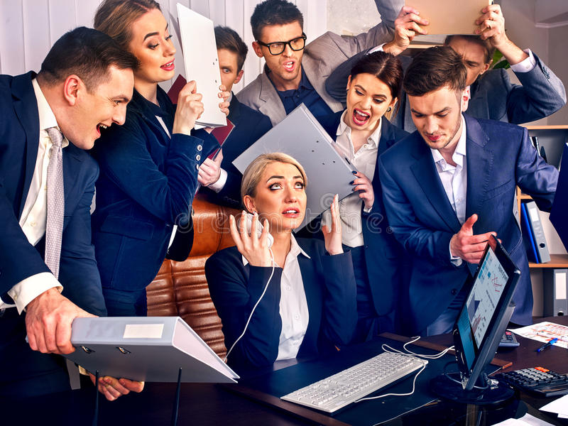 Business people office. Team people are unhappy with their leader. Intern manager does not cope with his duties. Crowd in stress stock photography