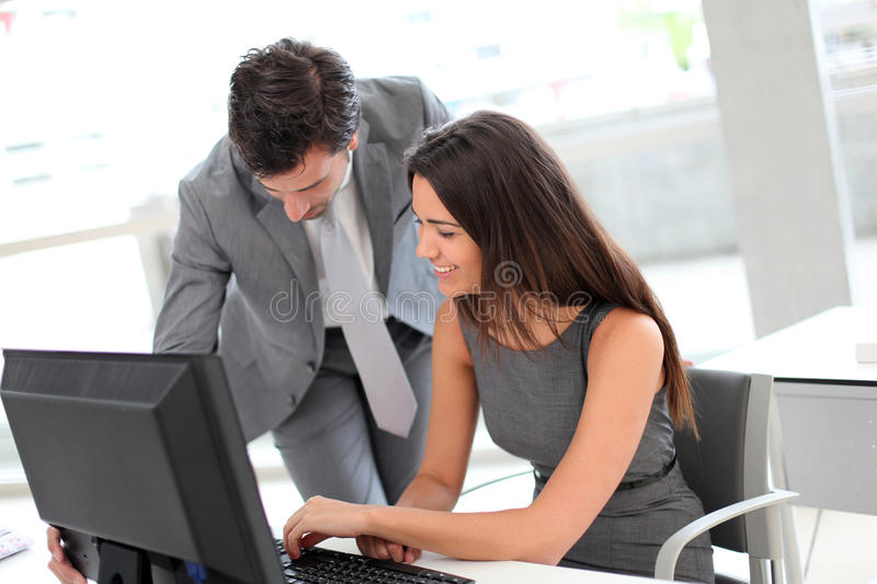 Business people at office working on computer stock images