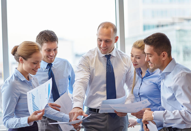 Business people with papers talking in office royalty free stock photos