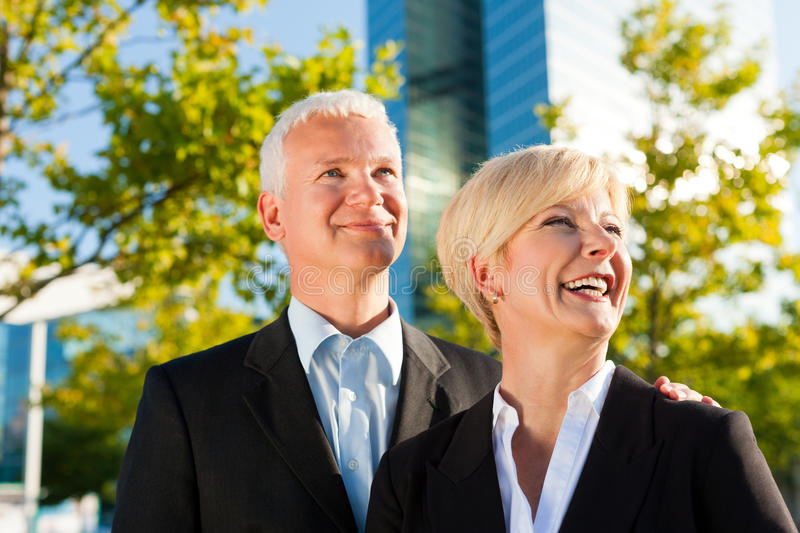 Business People In A Park Outdoors Stock Images