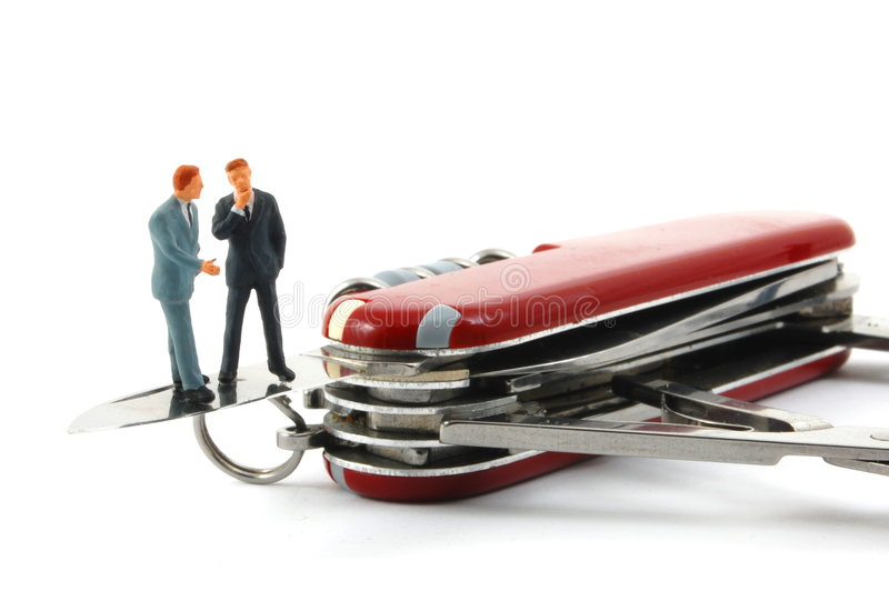 Business people on penknife stock images
