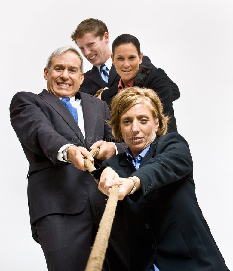 Business People Playing Tug-of-war Stock Photo