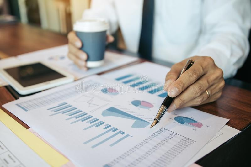 Business people pointing on statistic number result and analysis finance cost with checking summary reports graph in office.  stock image
