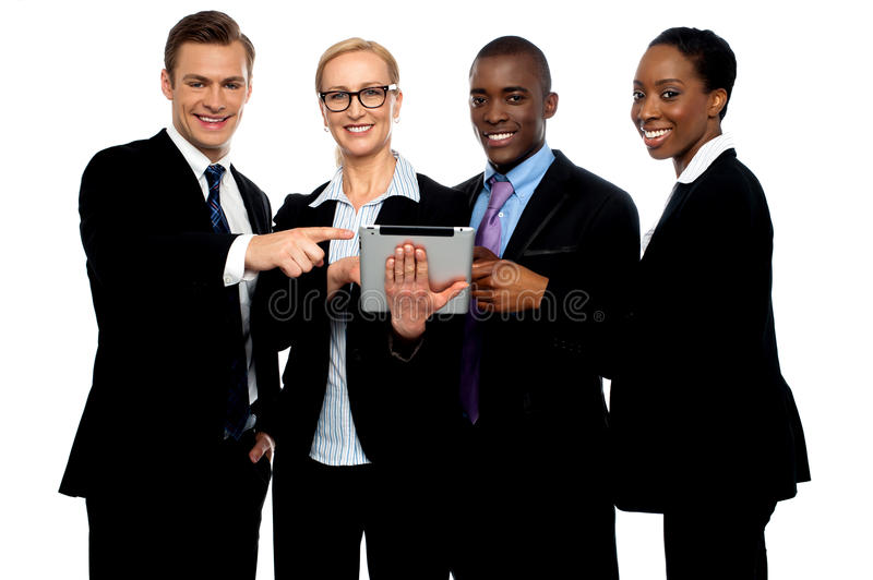 Business people pointing towards wireless tablet royalty free stock image