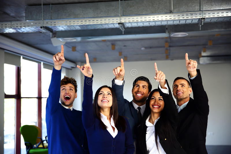 Business people pointing up stock image