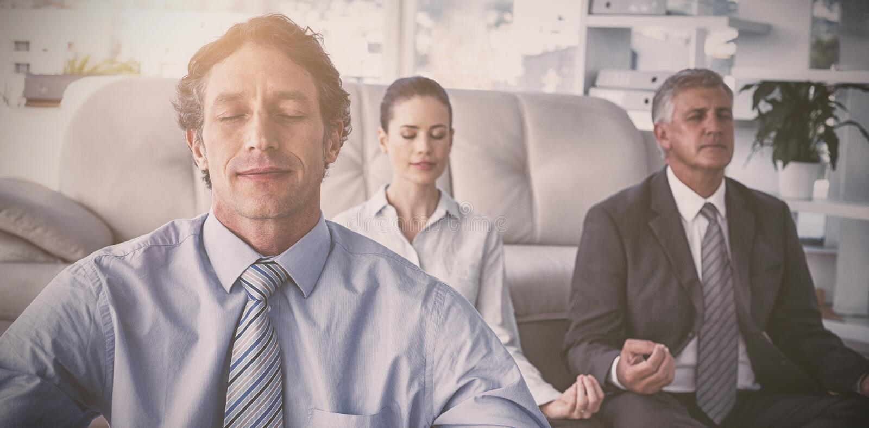 Business people practicing yoga stock image