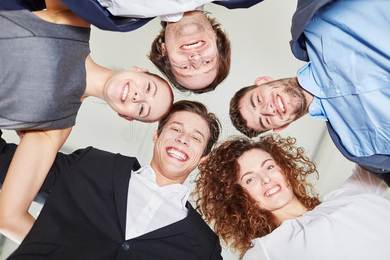 Business people putting heads together stock photos