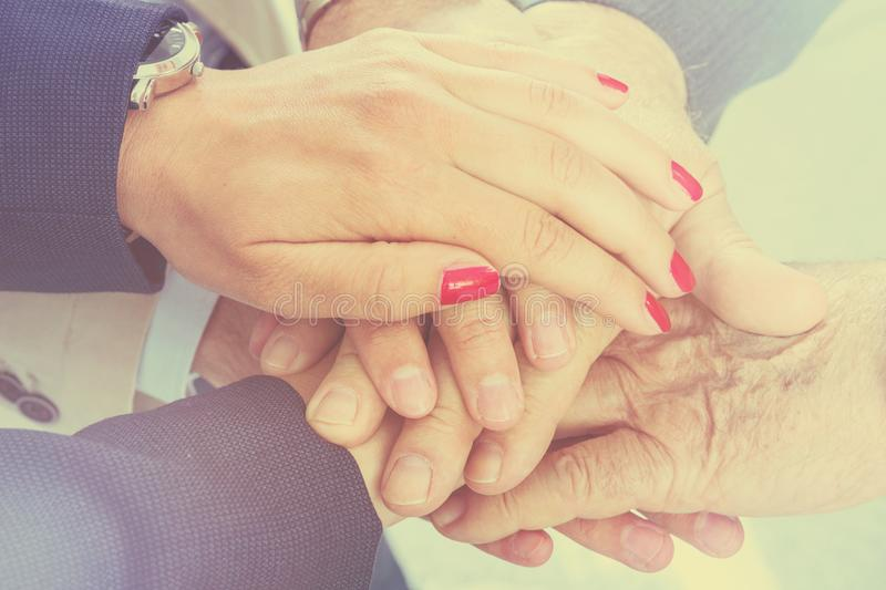 Business people putting their hands together. Arms consolidation royalty free stock photography