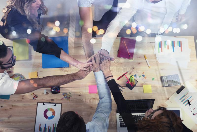 Business people putting their hands together. Concept of integration, teamwork and partnership. Double exposure stock image