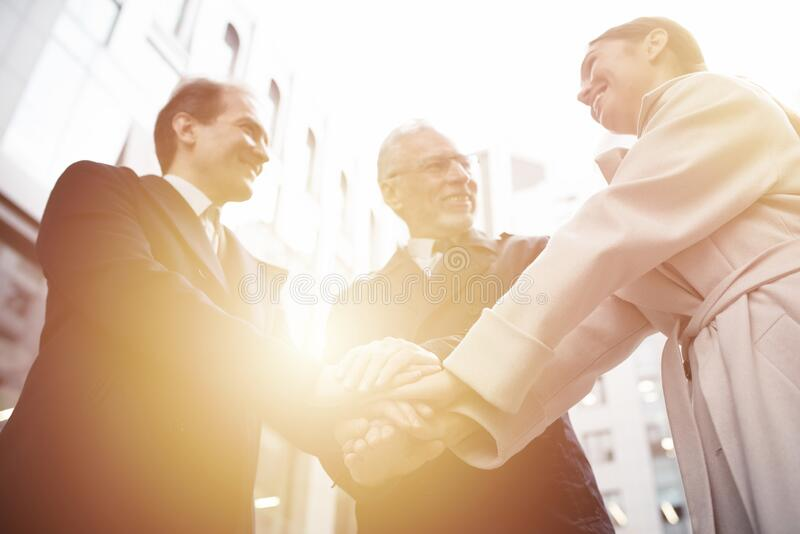 Business people putting their hands together. Concept of teamwork and partnership royalty free stock images