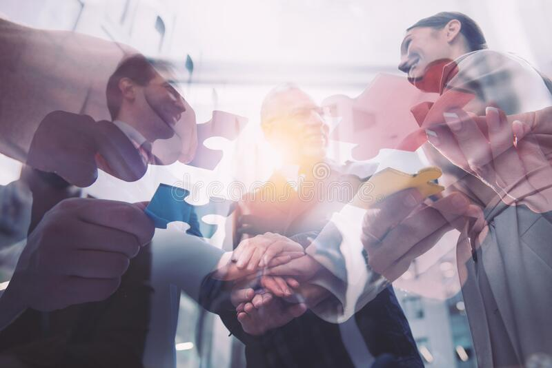 Business people putting their hands together. Concept of teamwork and partnership royalty free stock photo