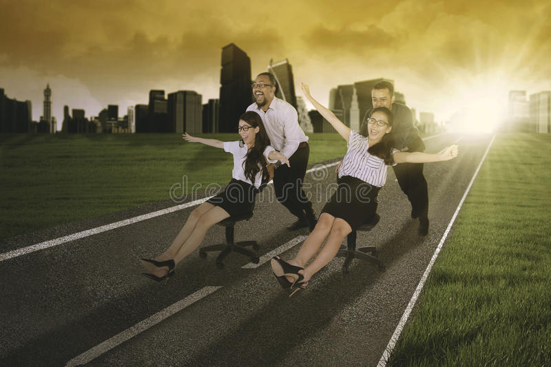 Business people racing on the road stock image