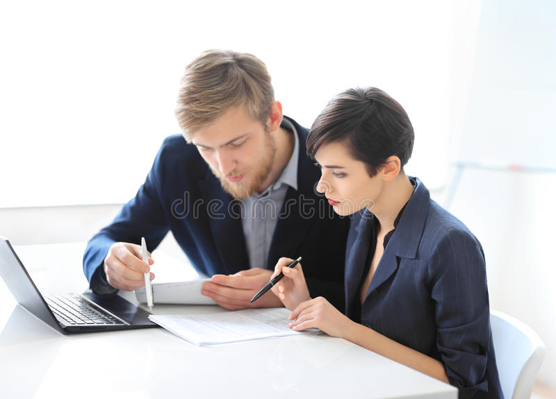 Business people reading contract stock photo