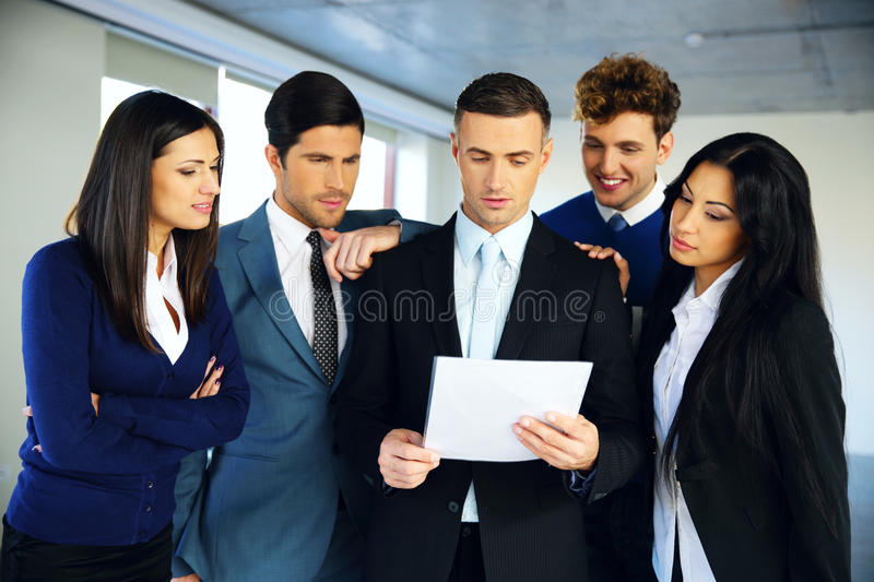 Business people reading a document stock photo