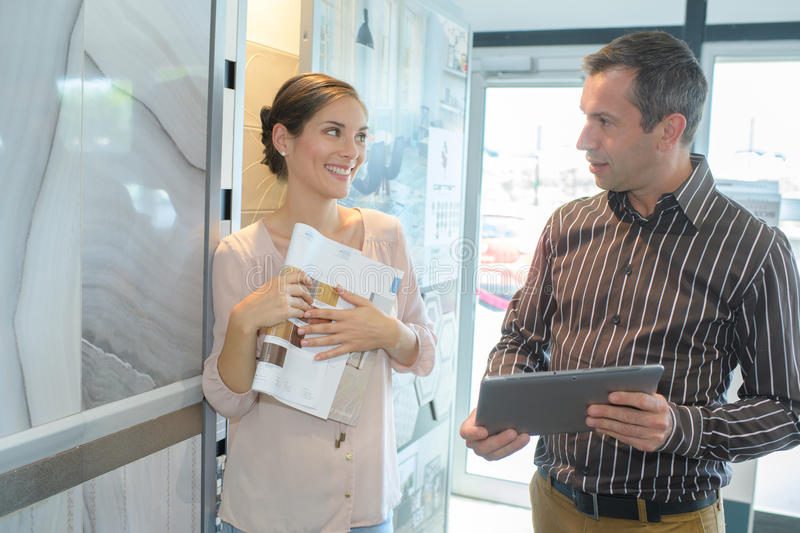 Business people reading document together stock photography