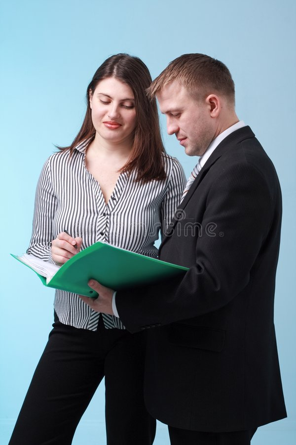 Business people reading documents royalty free stock images