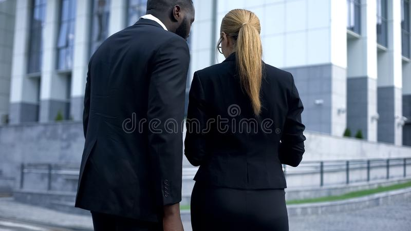 Business people reading documents, preparing speech before meeting, back view stock image