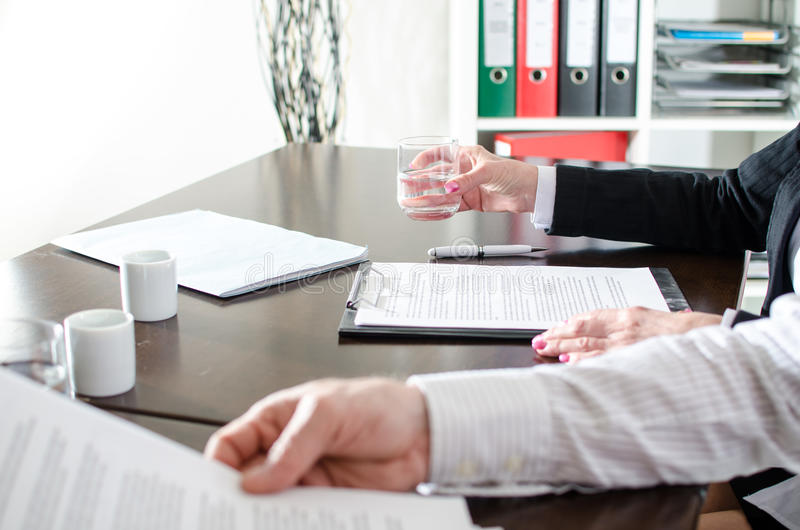 Business people reading documents stock photography