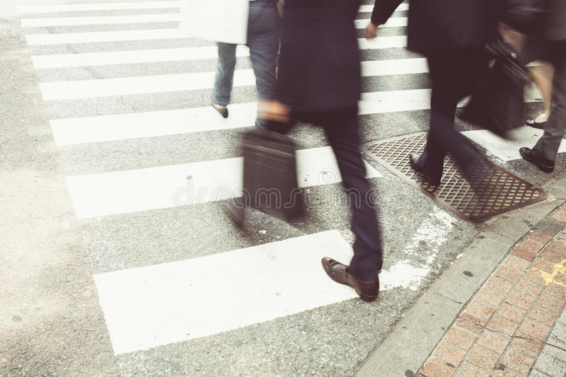 Business people at rush hour walking in the street, royalty free stock photos