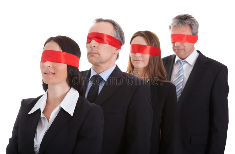Business people's eyes covered with ribbon stock image