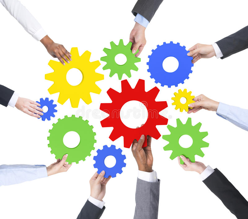 Business People s Hands Holding Cog royalty free stock image