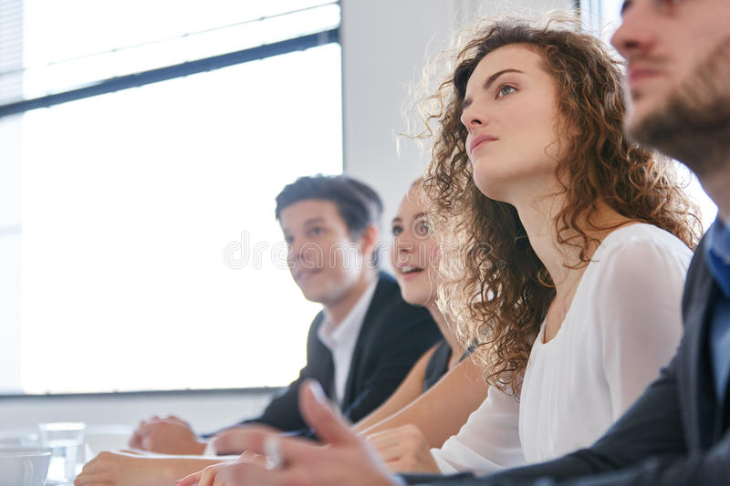 Business people in seminar stock photos