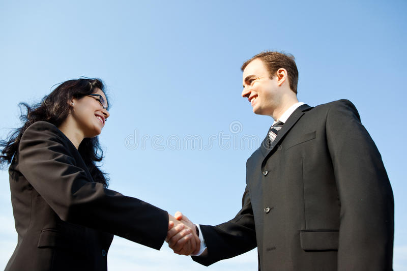 Business people shake hands royalty free stock image