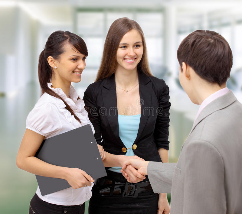 Business people shaking stock photos