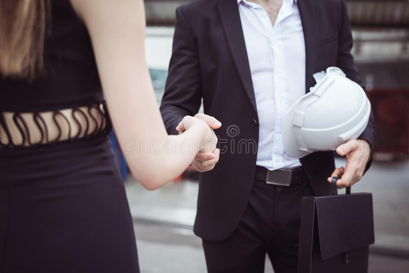 Business people shaking hand,Two confident partners finishing up meeting stock photo