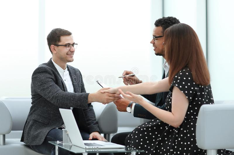 Business people shaking hands after a business meeting royalty free stock images