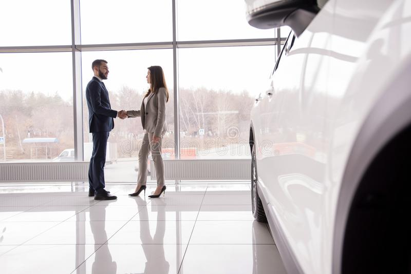 Business People Shaking Hands by Car royalty free stock photo