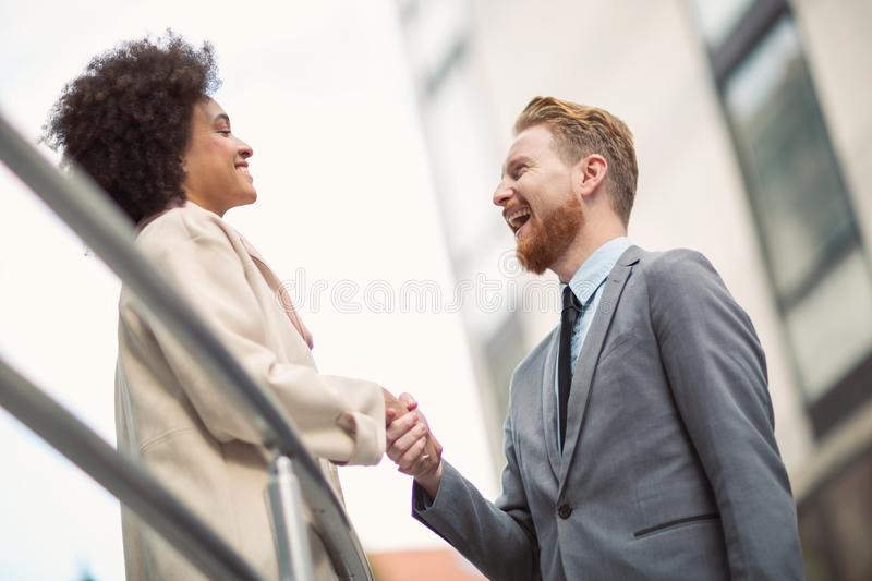 Business people shaking hands on city street royalty free stock photo