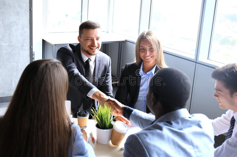 Business people shaking hands, finishing up a meeting. stock photography