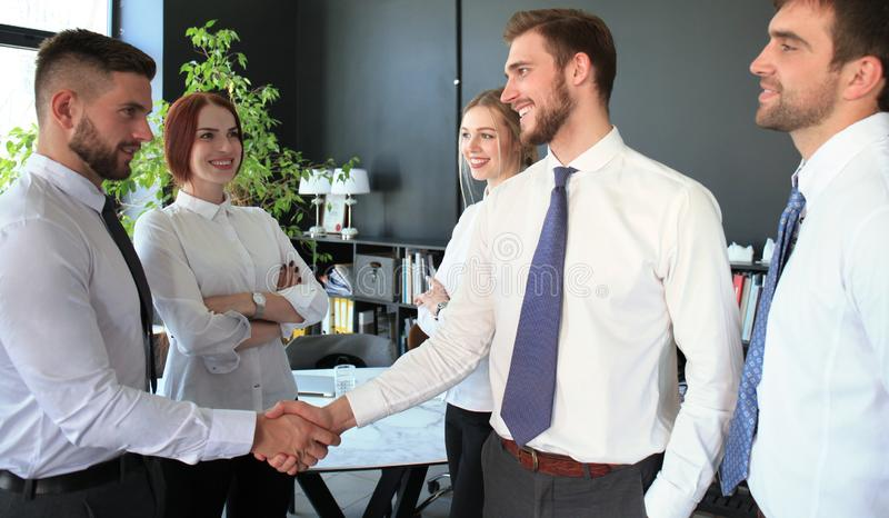 Business people shaking hands, finishing up a meeting stock images